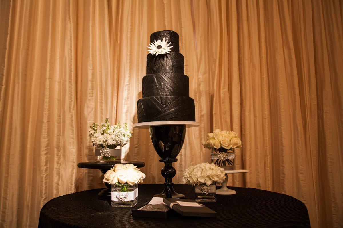 Black cake table with orange draping ScoobieWestCo._INIJE-22