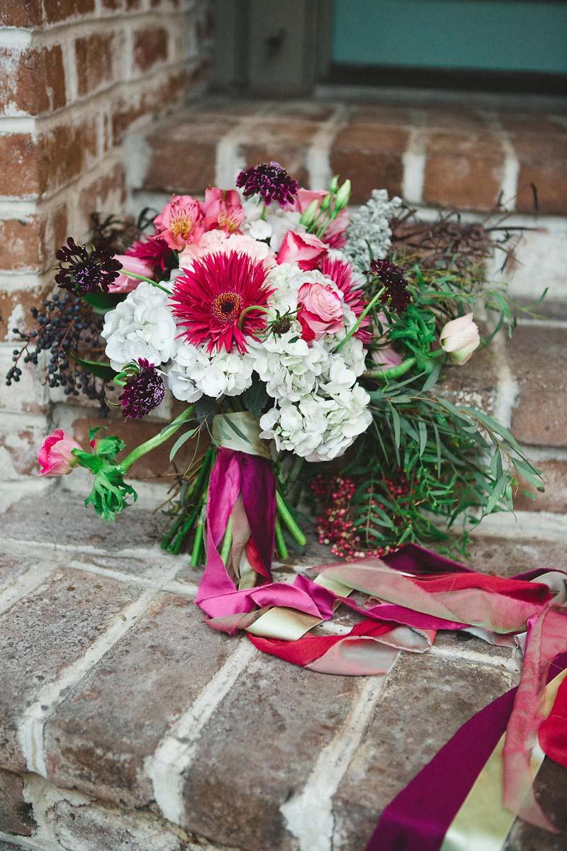 Bridal bouquet brick backdrop