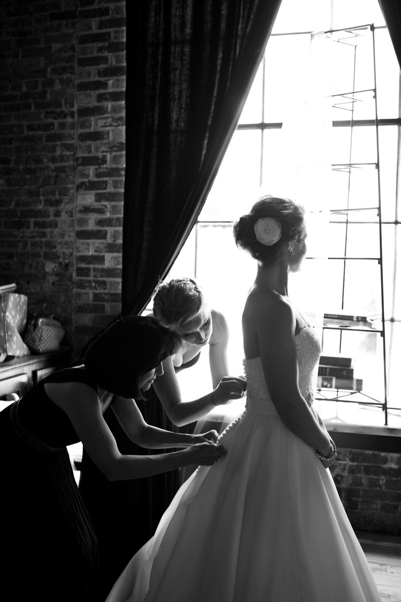 Bride Getting Ready at Window - Tessa Marie Weddings