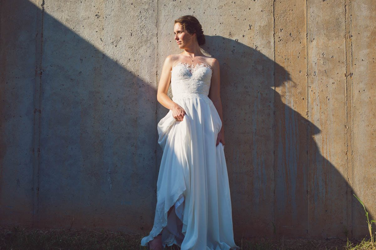 Bride against wall in her gown - Adam for W.Scott Chester