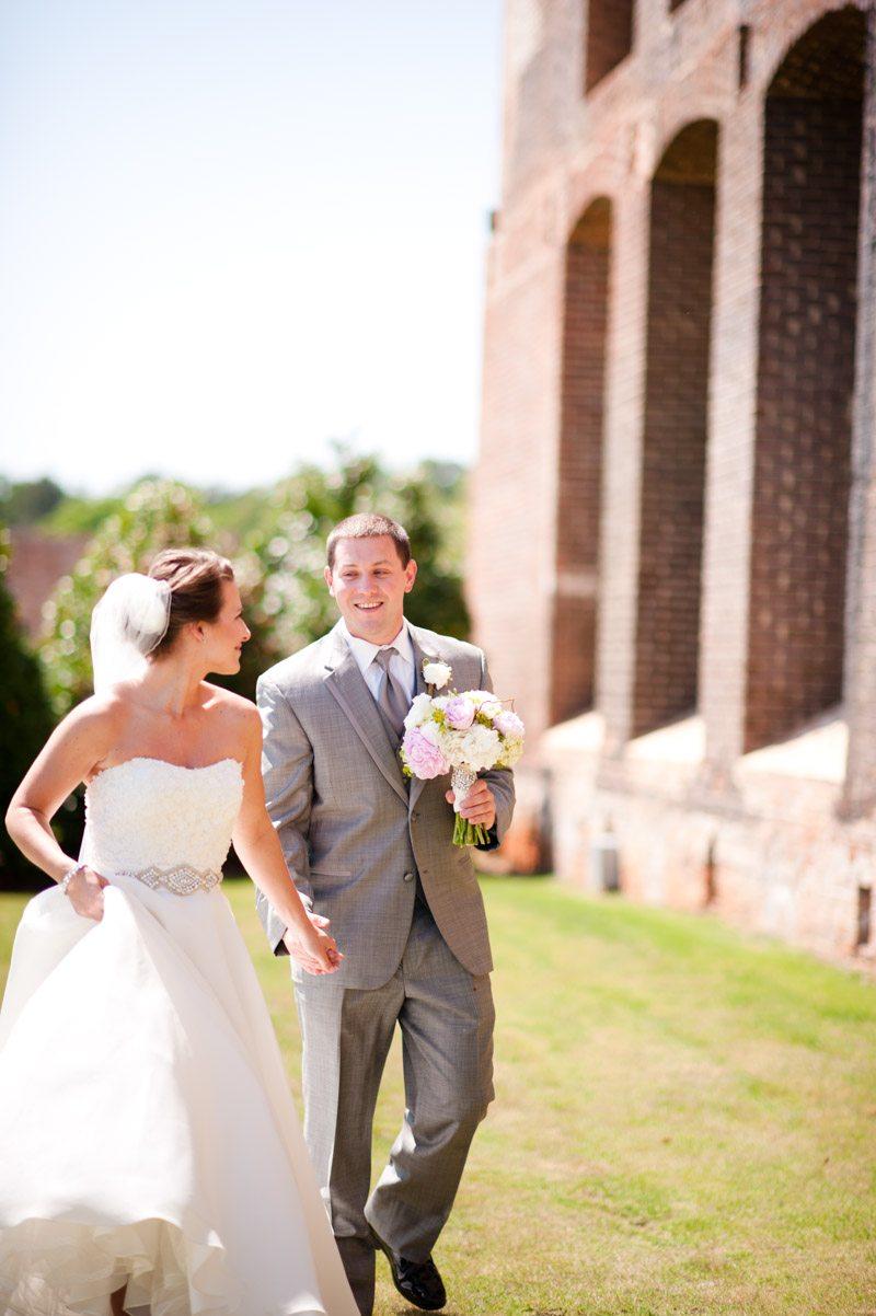Bride and Groom Walking Outside VEnue - Tessa Marie Weddings
