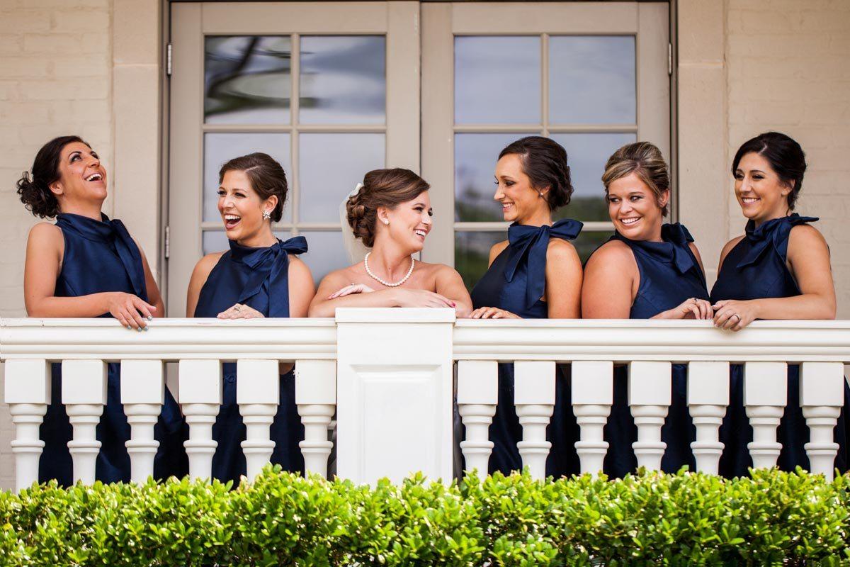 _Bride and bridesmaids outside on balcony Herndon_Herndon_Sharon_Theresa_Wheaton_20150627sharontheresawheaton1016