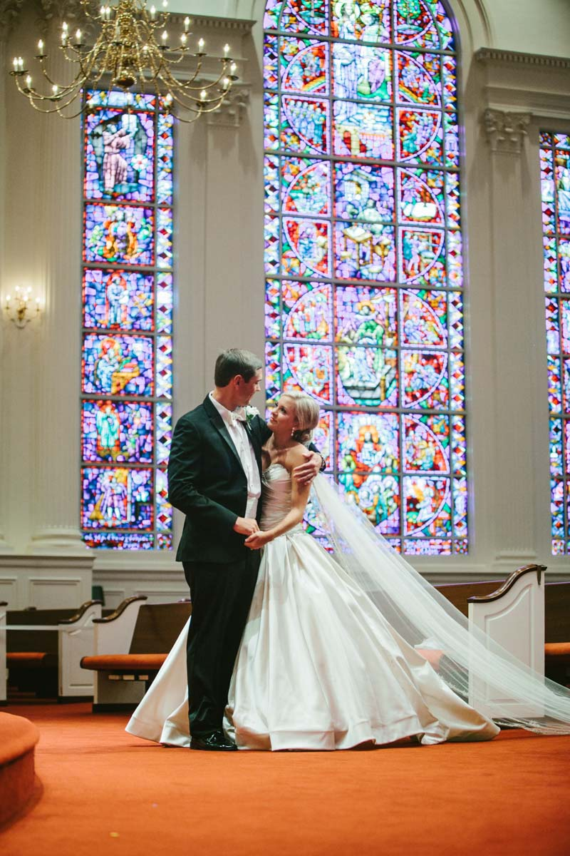 _Bride and groom inside church under stain glass window katelyntaylor-0182