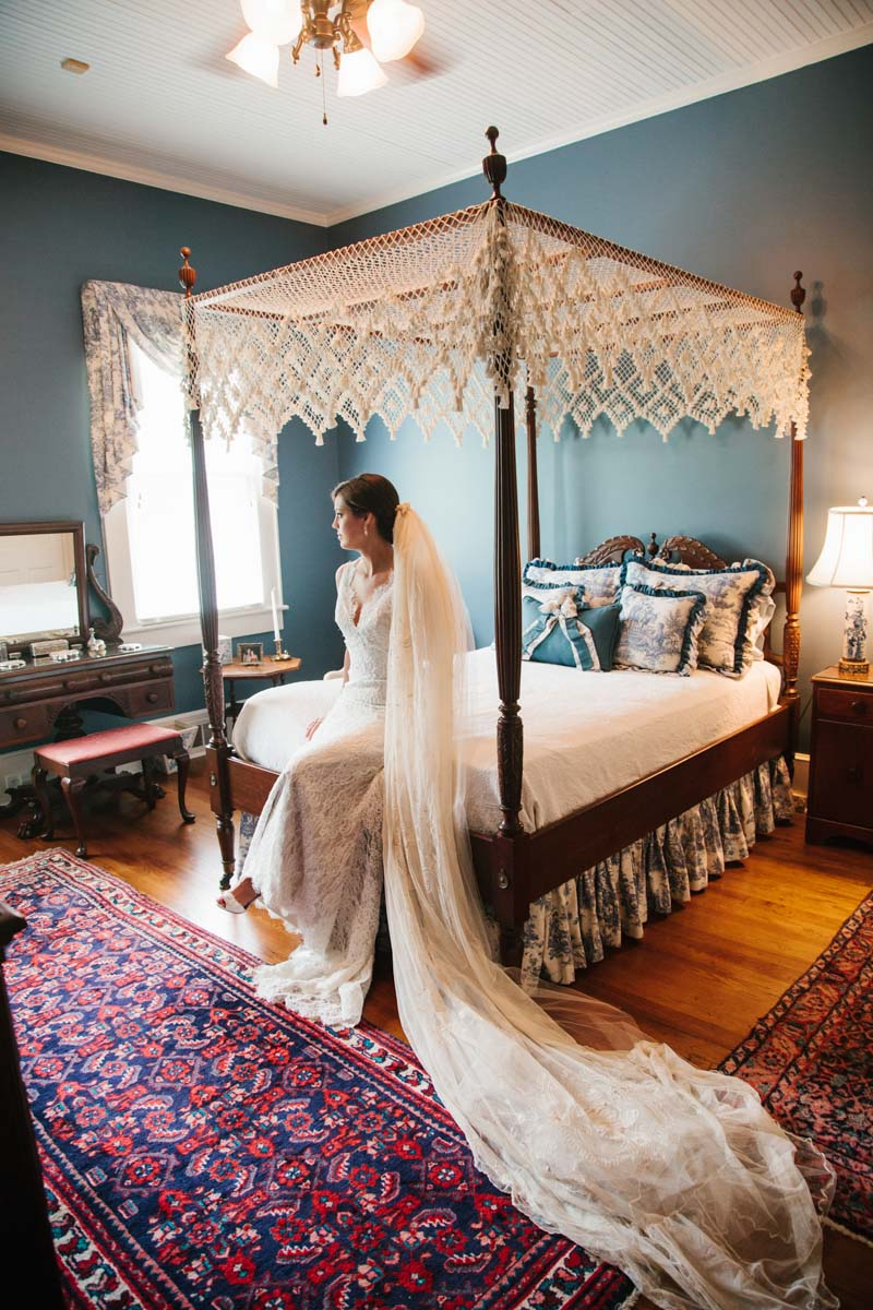 Bride in dress on bed