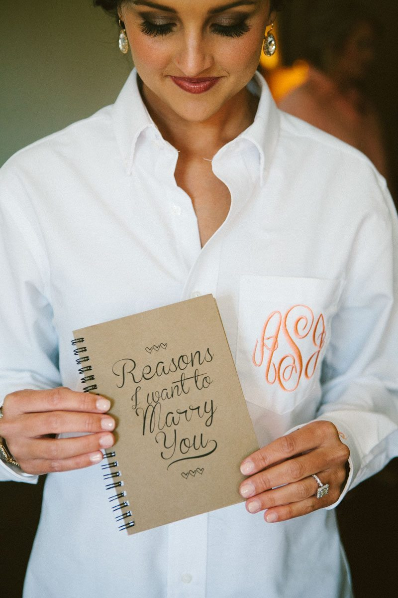 Bride in monogramed shirt makeup done holding notebook ansleycarson-0033