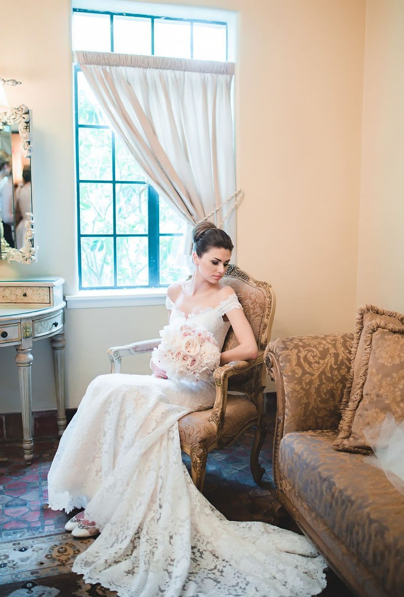Bride next to window before ceremony - Tara Tomlinson PHotography