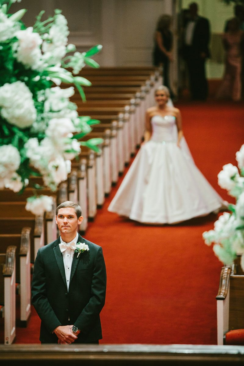 _Bride walking up red carpet and groom waiting in focus katelyntaylor-0169