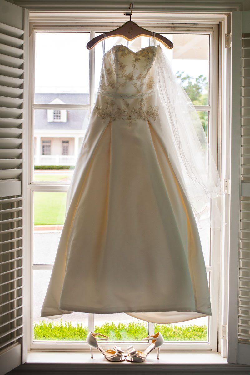 _Bride's gown hanging in window Herndon_Herndon_Sharon_Theresa_Wheaton_20150627sharontheresawheaton1008