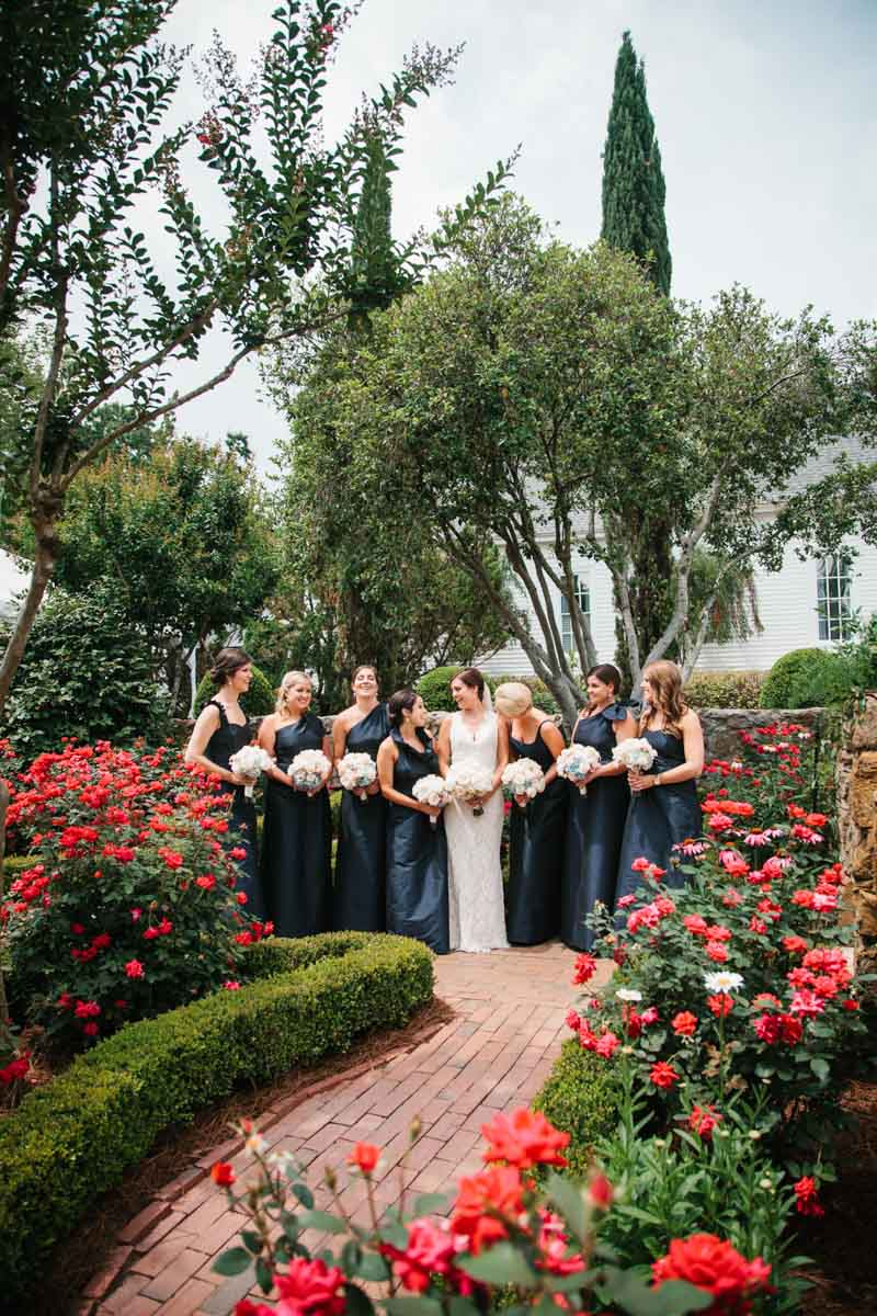Bridesmaids outside with flowers