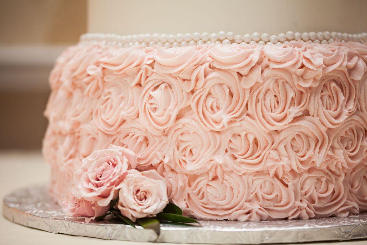_Cake bottle close up with pink roselettes Herndon_Herndon_Sharon_Theresa_Wheaton_20150627sharontheresawheaton1079