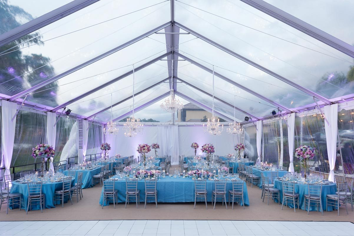 _ Clearspan tent long shot reception overview with purple uplighting Diaz_Gonzalez_Kathy_Thomas_Photography_KathyThomasPhotographyGonzalez51