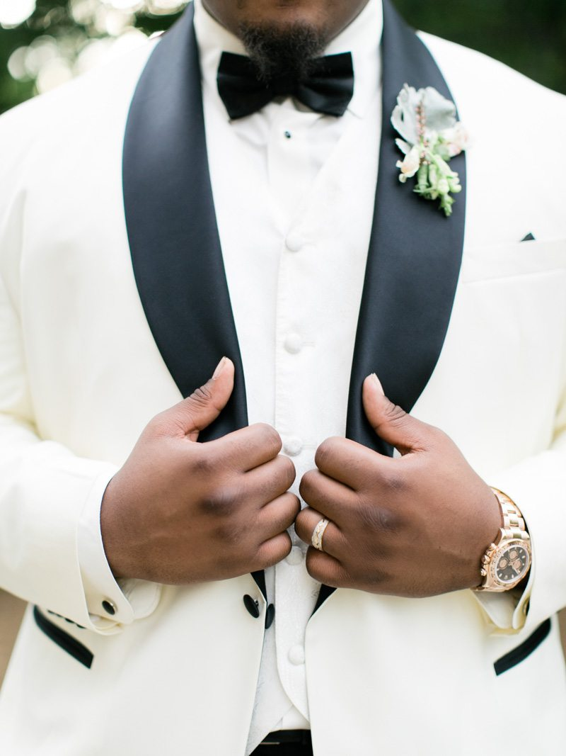 Close Up of Groom Featuring Boutonniere - Morning Light by Michelle Landreau