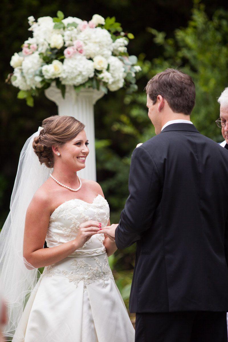 _Exchanging rings during ceremony bride focus Herndon_Herndon_Sharon_Theresa_Wheaton_20150627sharontheresawheaton1034