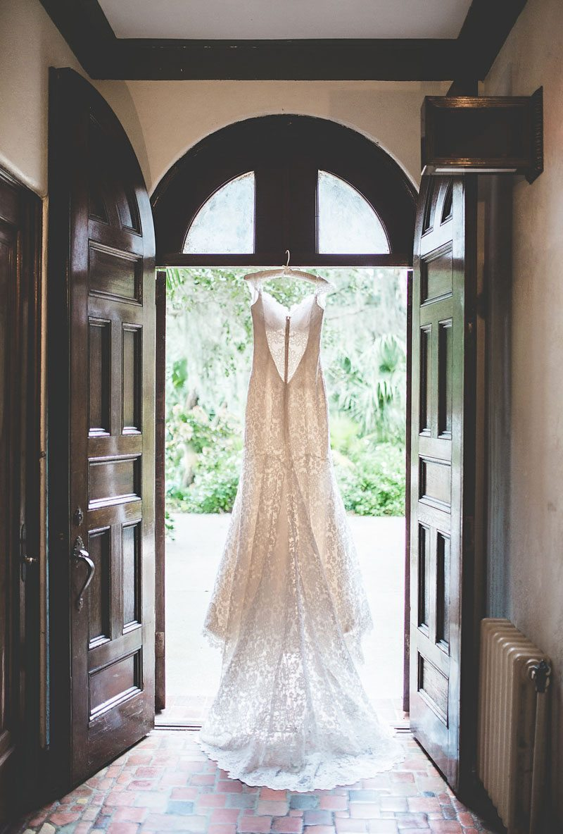 Gown Hangning in Door Frame - Tara Tomlinson Photogrpahy