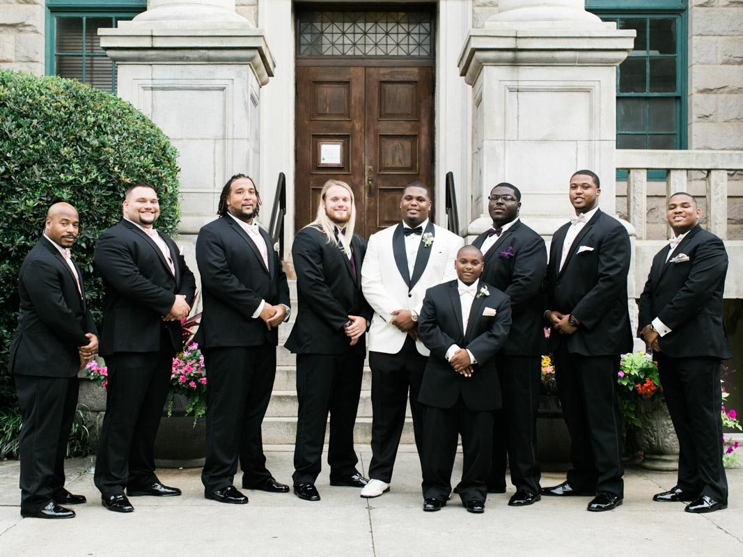 Groom and Groomsmen outside Ceremon Venue - Morning Light by Michelle Landreau