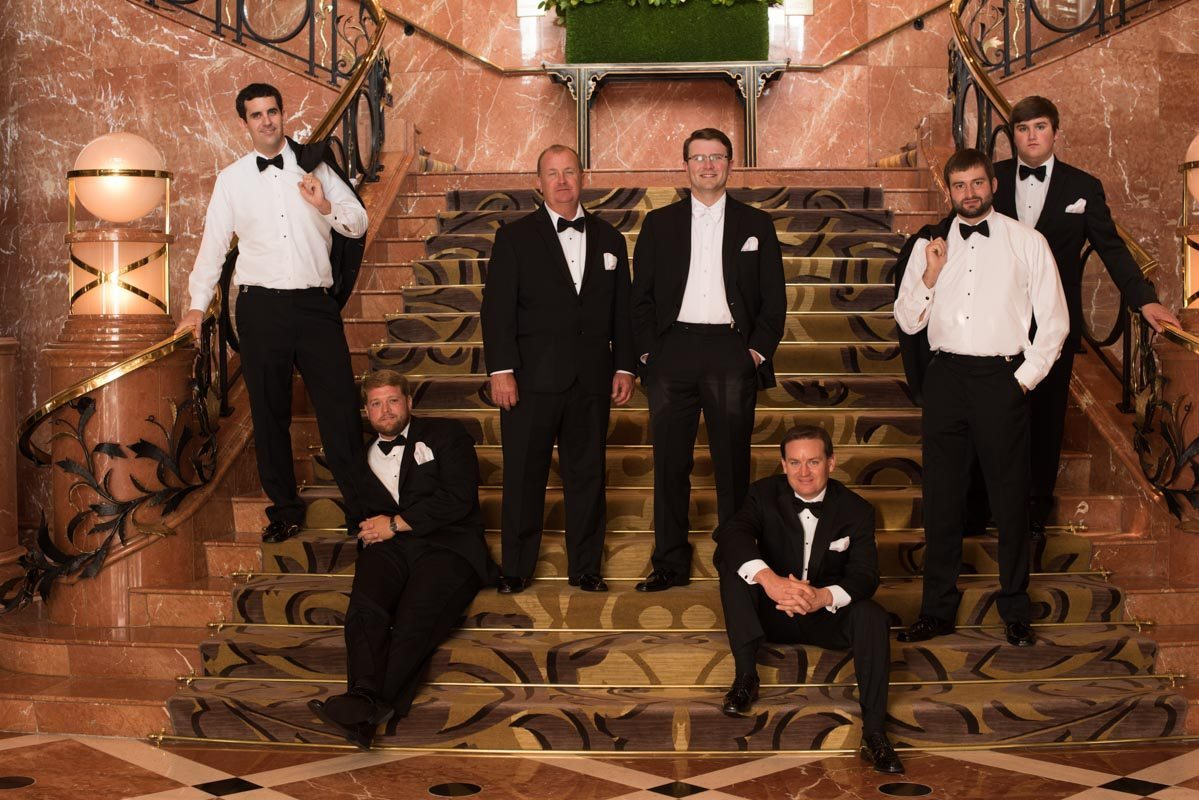 Groomsmen lounging on stairs Callaway_Cook_Moreland_Photography_Cook249