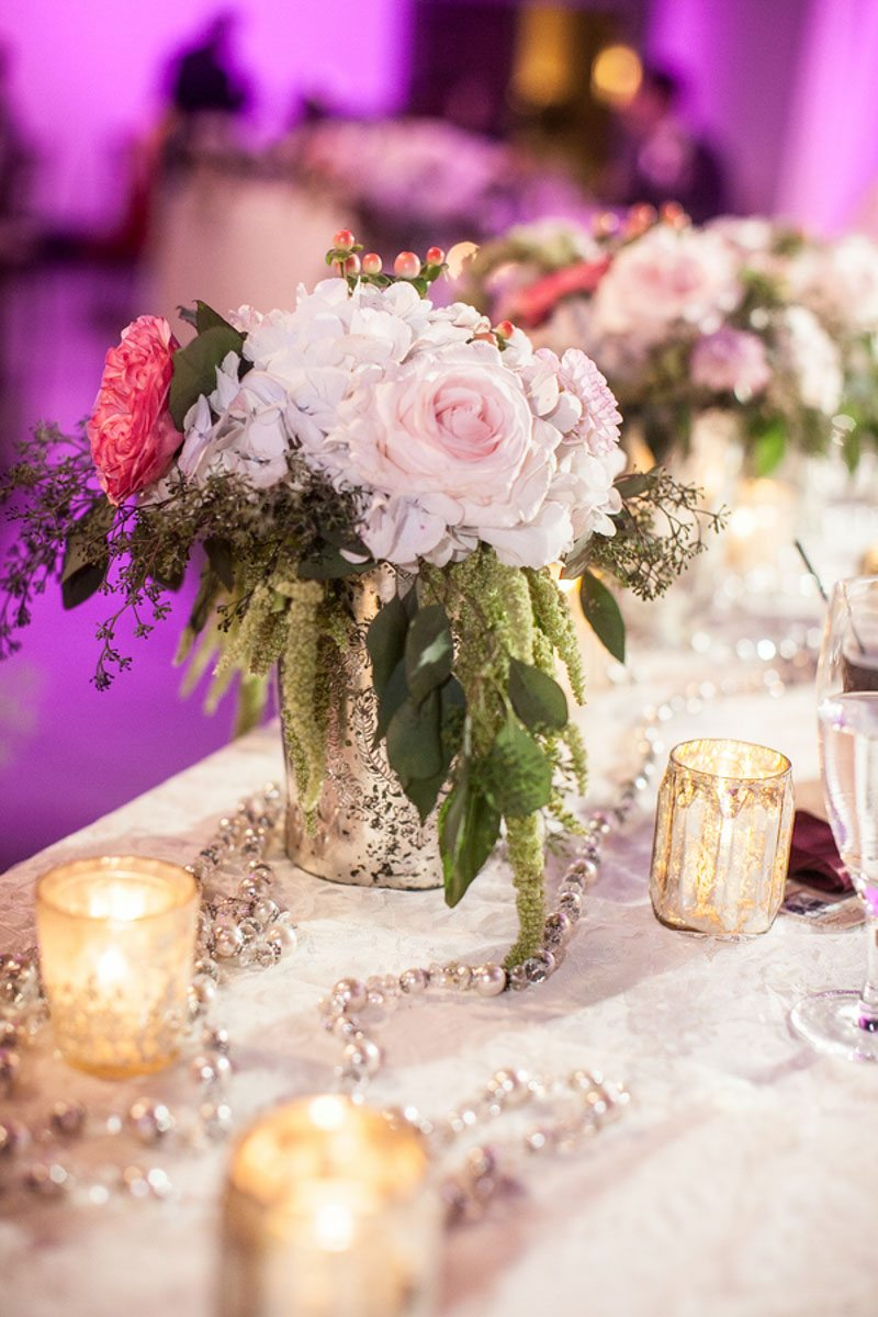 Pink Flowers with Candles on Table