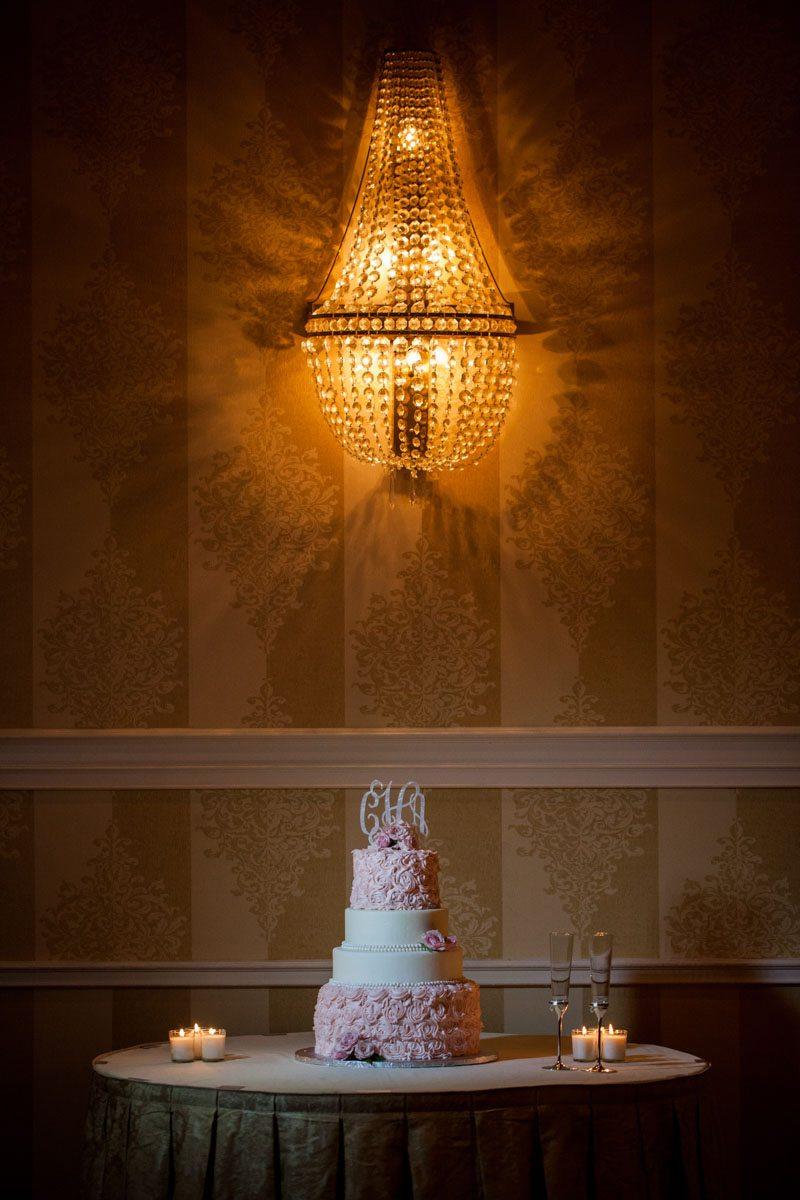 _Pink and white cake long shot with chandelier background Herndon_Herndon_Sharon_Theresa_Wheaton_20150627sharontheresawheaton1055
