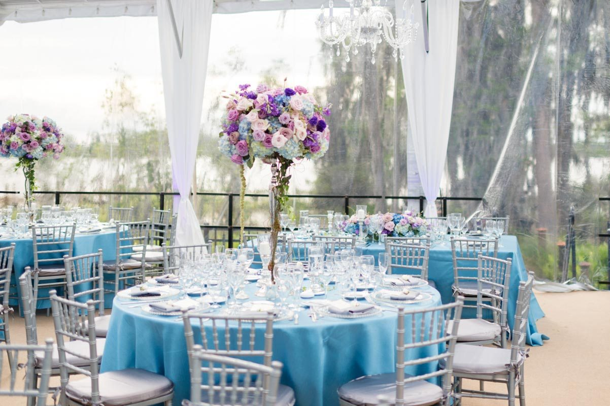 _Reception round table blue linen purple centerpiece Diaz_Gonzalez_Kathy_Thomas_Photography_KathyThomasPhotographyGonzalez43