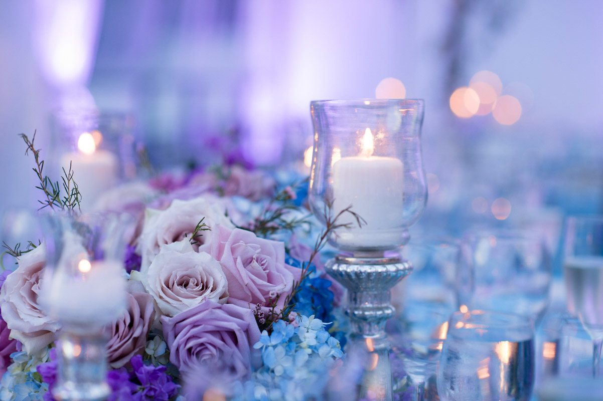 _Reception table purple uplighing candle and rose centerpiece Diaz_Gonzalez_Kathy_Thomas_Photography_KathyThomasPhotographyGonzalez54