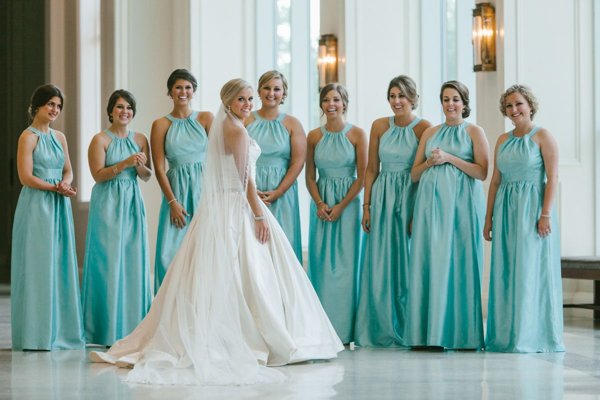 _The bride in middle and bridesmaids in aqua gowns katelyntaylor-0138