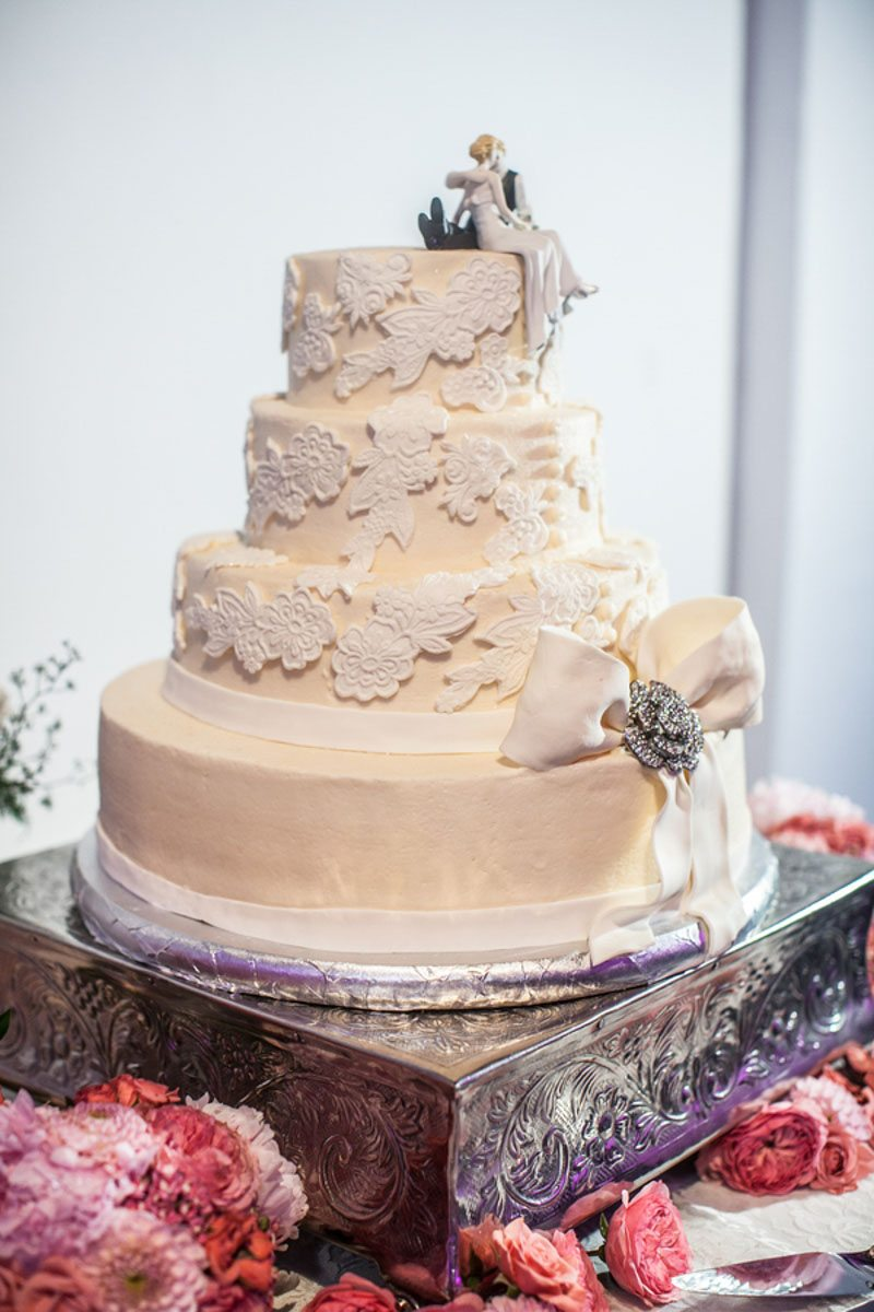 Triple Tiered Cream and White Cake With Bow