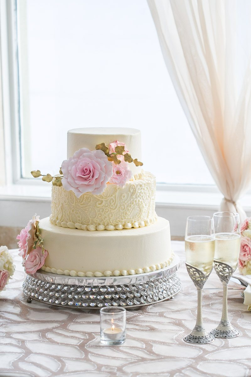 Triple Tiered Off White Cake with Pink Flowers