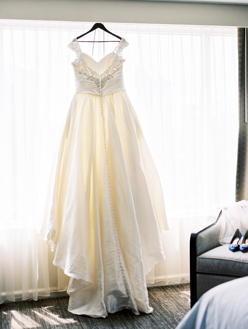 Wedding Gown Hanging in Window - Morning Light by Michelle Landreau