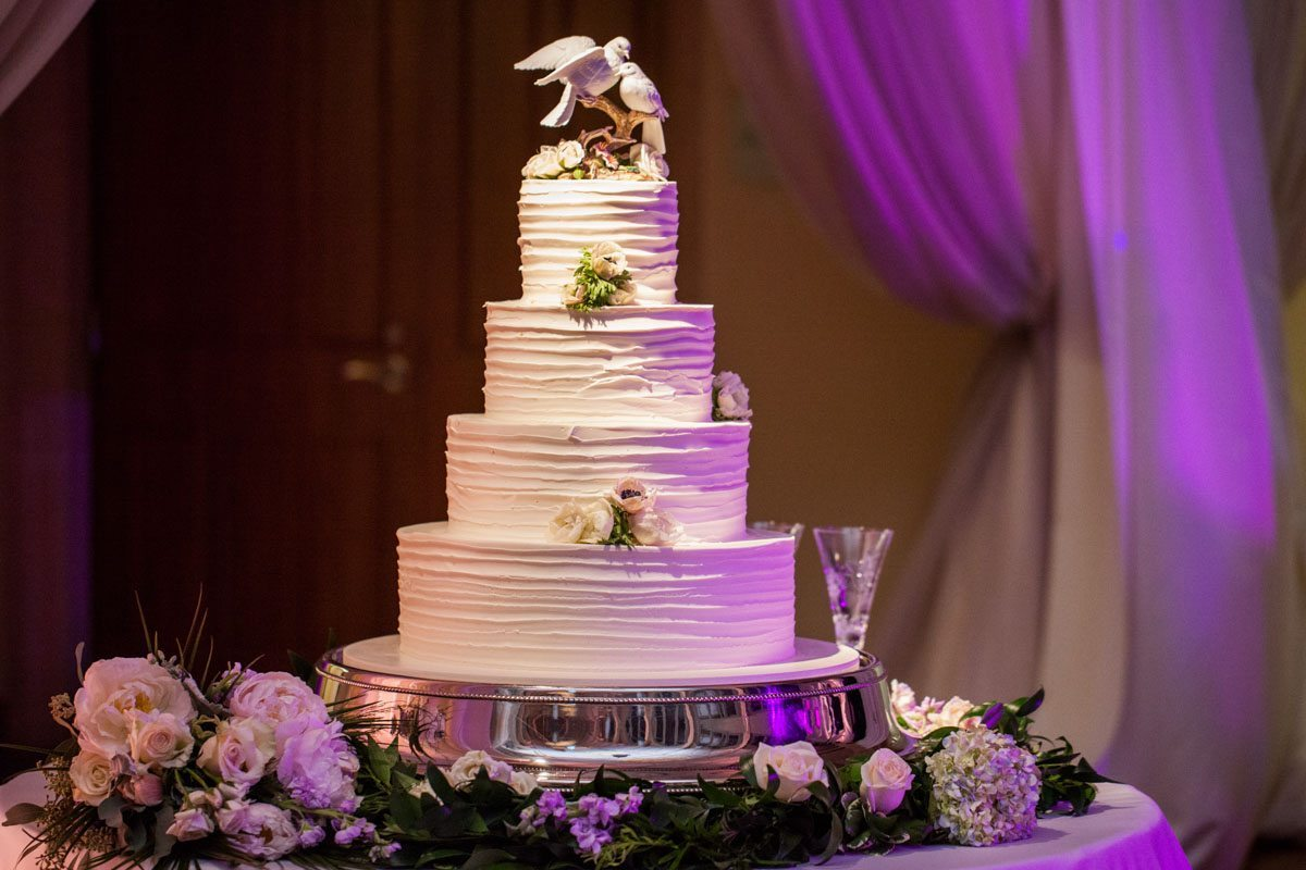 Wedding cake with purple uplighting Beavor_Case_Sharon_Theresa_Wheaton_20151114sharontheresawheaton1127