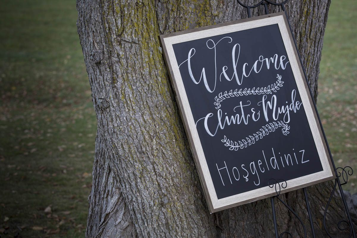 Welcome Chalkboard Against Tree