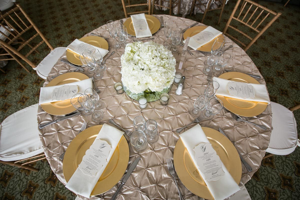 White Flowers Gold Plates Table Setup