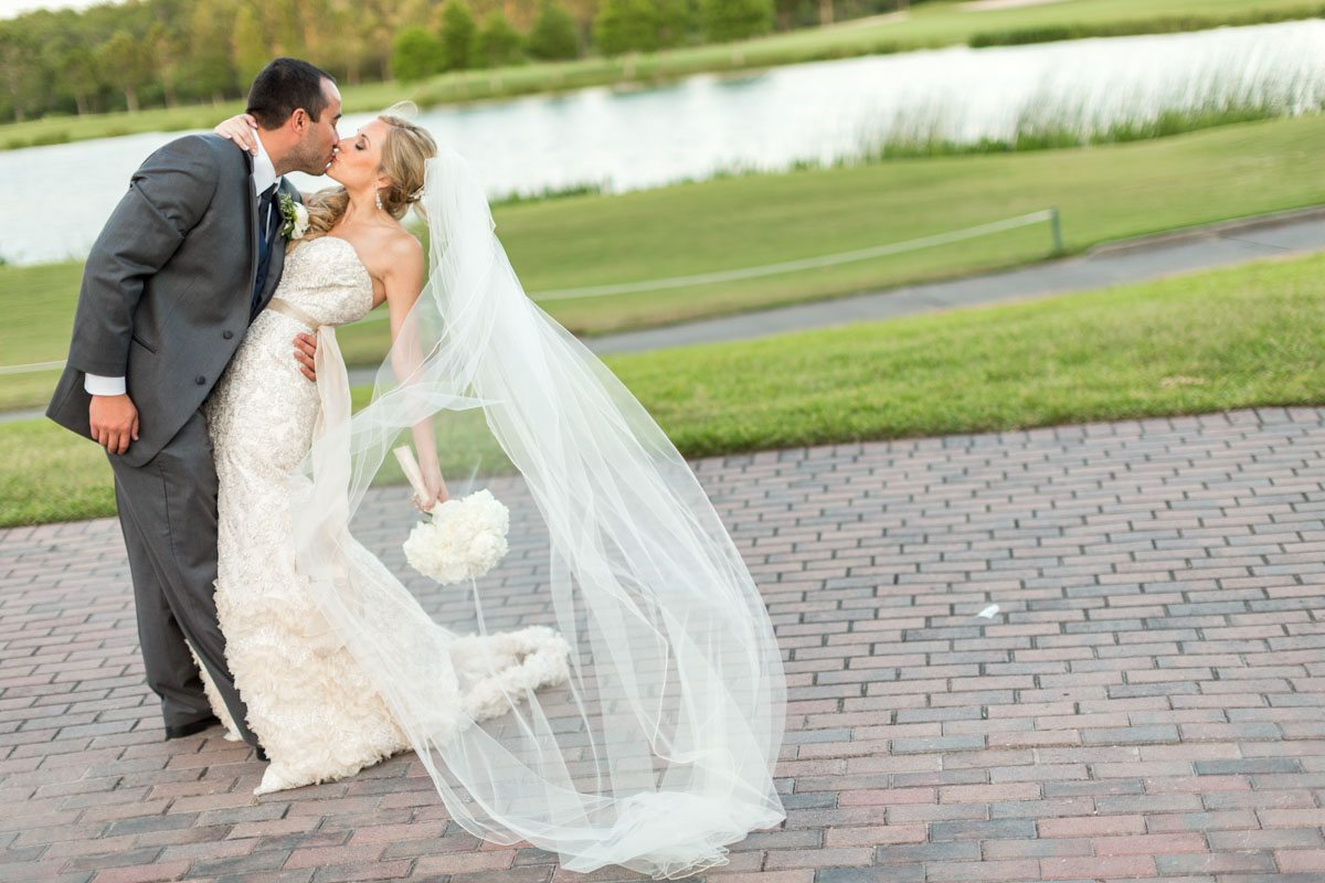 bride and groom kiss - Victoria_Angela_Photography_20130525calderonfizer0398