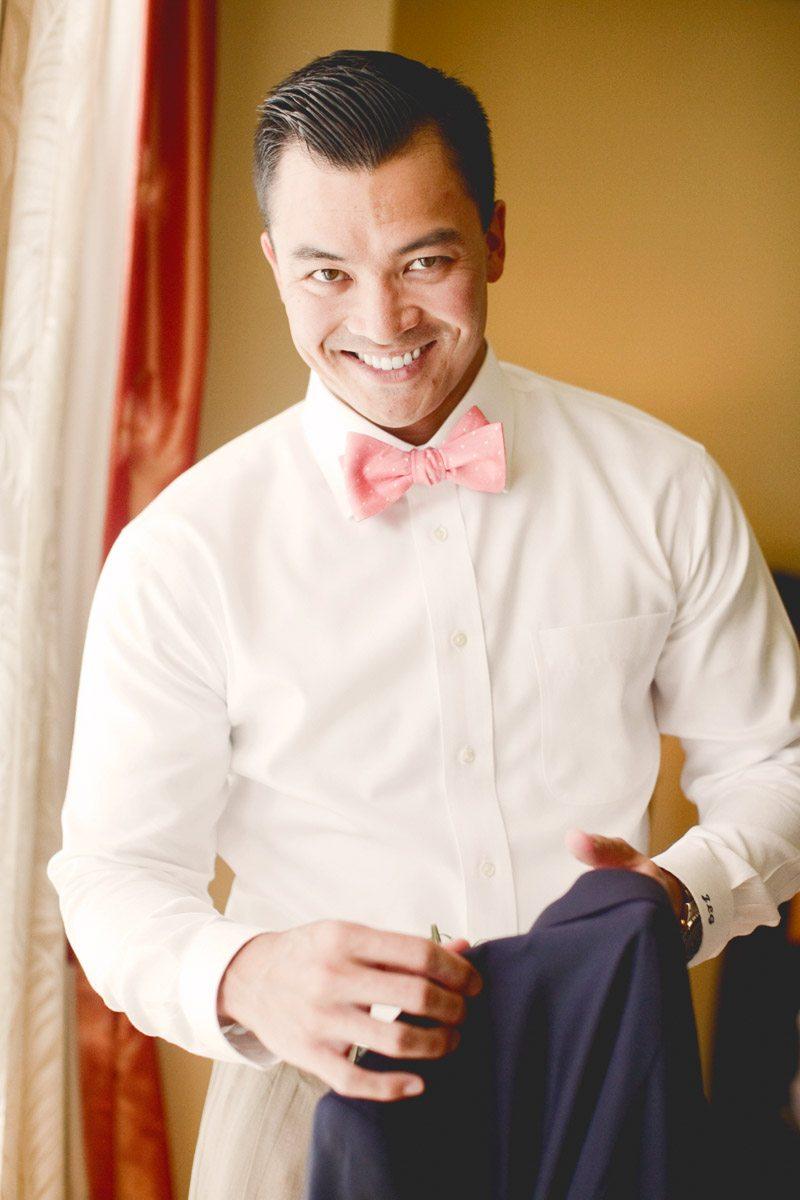 groom getting ready bowtie