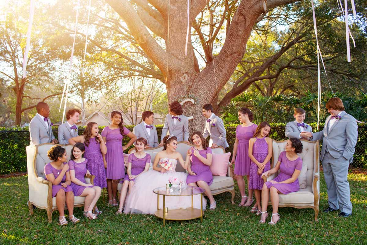 Birthday Girl and Friends in Purple Dresses Gray Suits