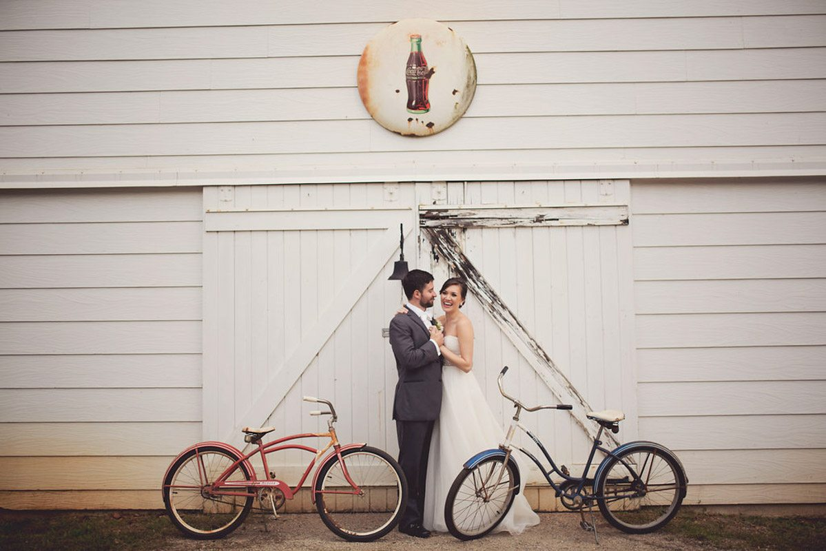 Bride & Groom Red & Blue Bikes old white barn