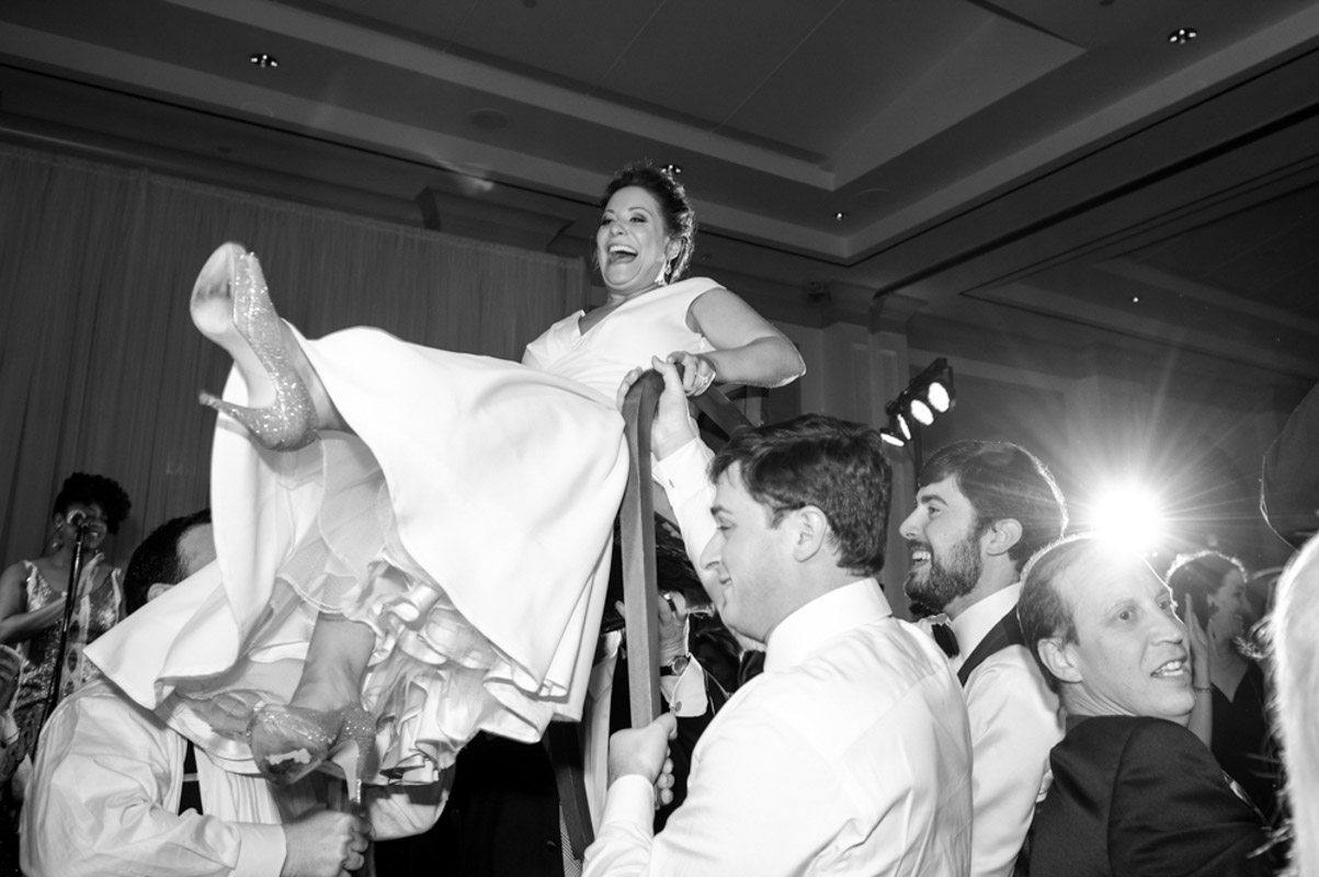 Bride Lifted in Chair Black and White
