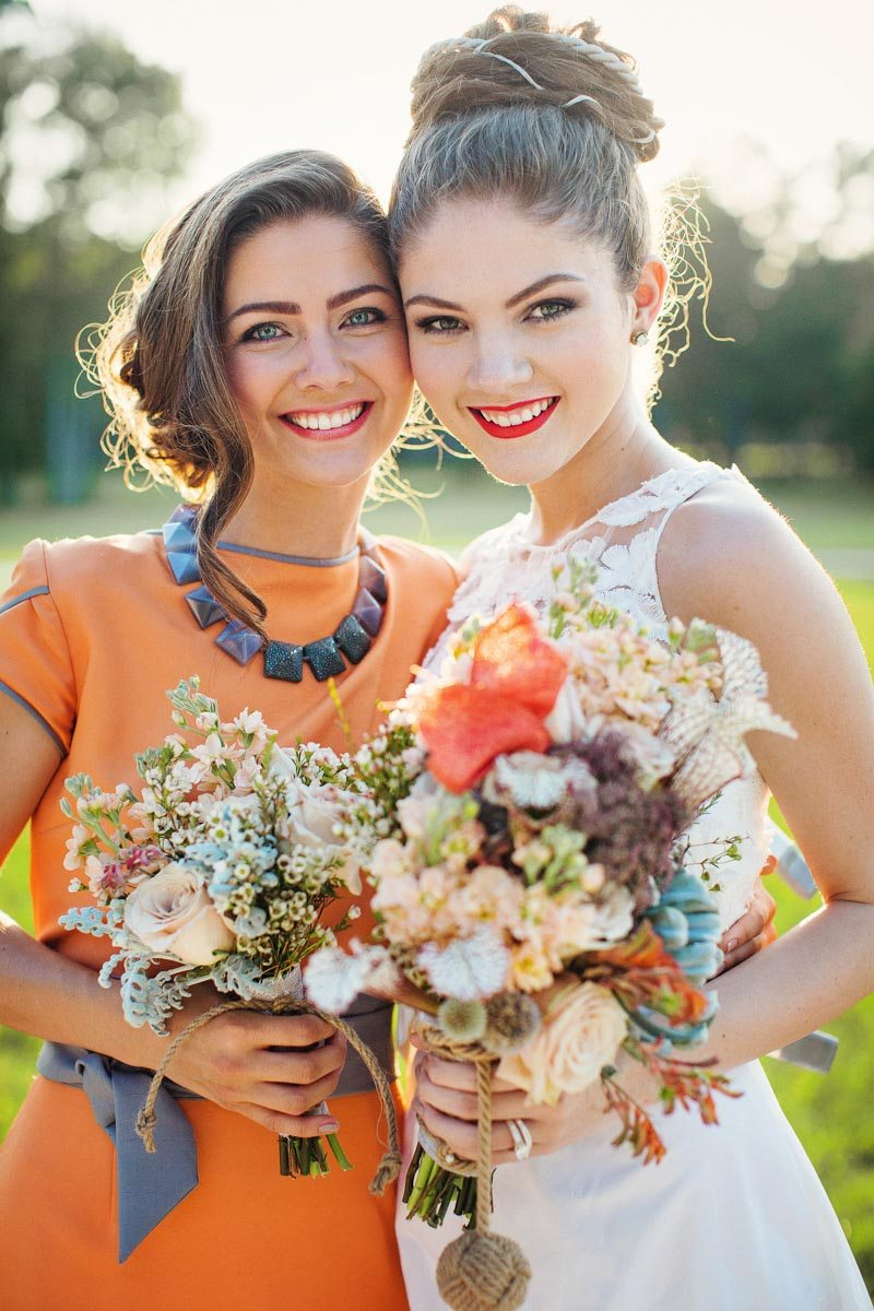 Bride and Bridesmaid Featuring Bouquets - Izzy Hudgins Photography