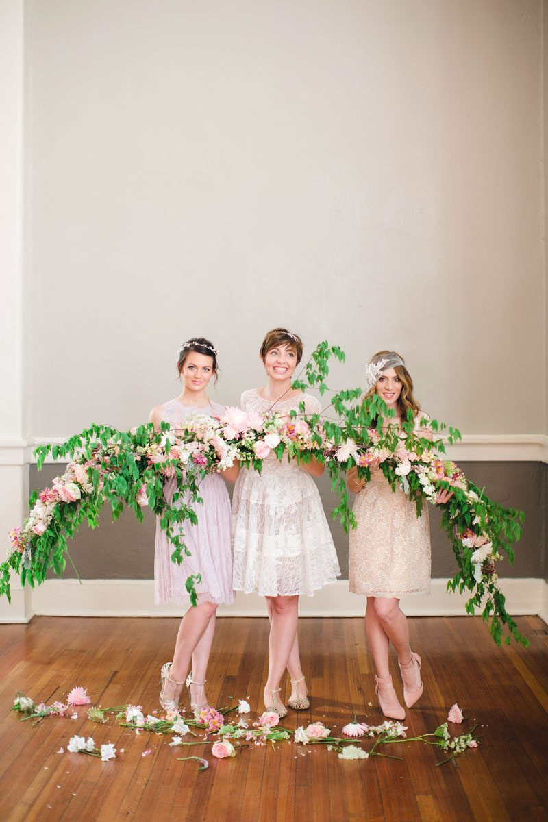 Bride and Bridesmaids Holding Pink and Green Centerpiece