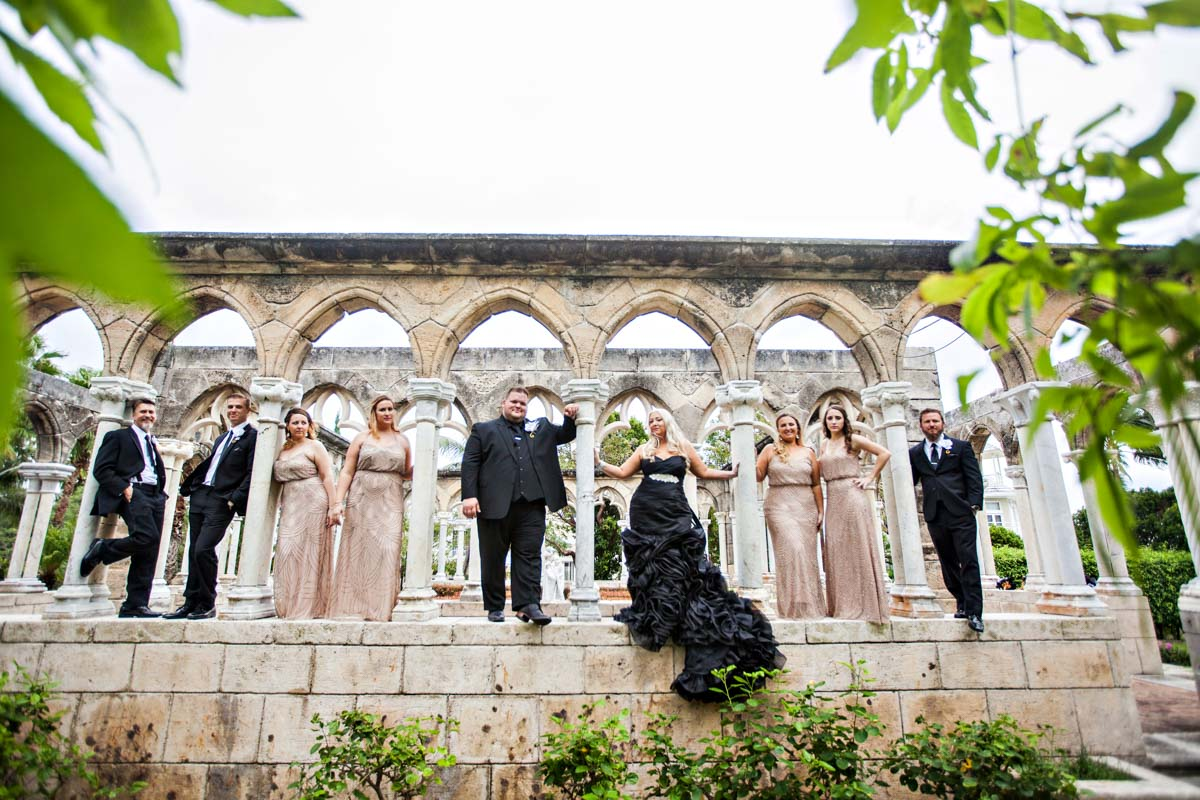 Bride and Groom With Wedding Party Standing in Arches