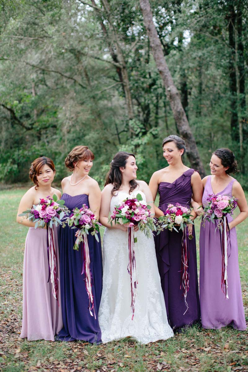 _Bride and bridesmaids in purple hues holding bouquets with ribbons Obert_Taylor_Ais_Portraits_AisPortraitsBryanTori59