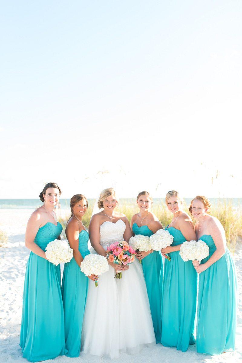 Bride and bridesmaids on beach formal shot Pearl_Warnock_Caroline__Evan_Photography_MichaelaChrisWedding1416