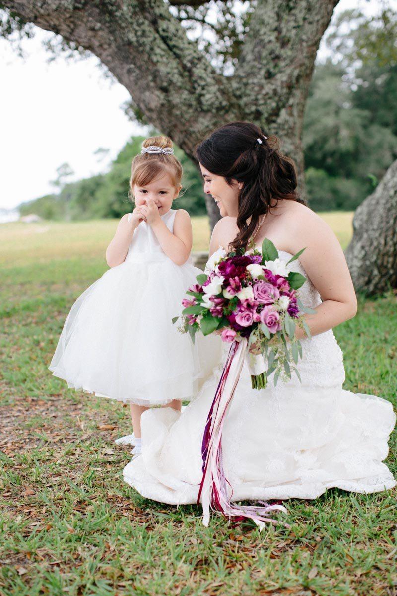 _Bride bending down with flower girl Obert_Taylor_Ais_Portraits_AisPortraitsBryanTori200