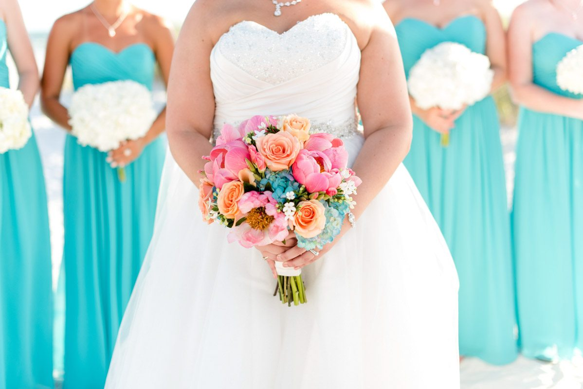 Bride bouquet close up with bridesmaids in background Pearl_Warnock_Caroline__Evan_Photography_MichaelaChrisWedding1451