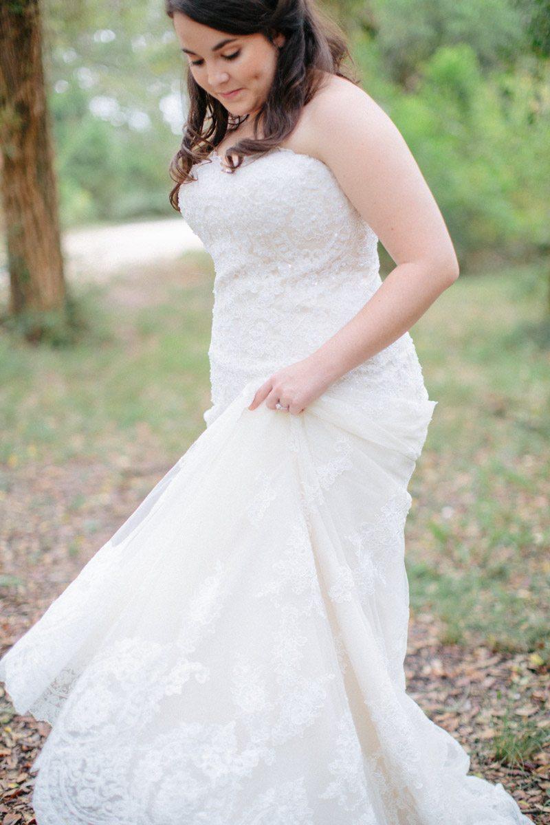 _Bride walking and holding dress gazing down Obert_Taylor_Ais_Portraits_AisPortraitsBryanTori47