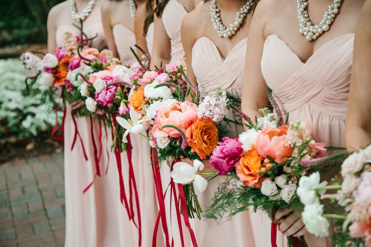 Bridesmaids Holding Pink White Orange Bouquets