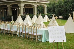 Camp Sienna Sign with Teepee Tents