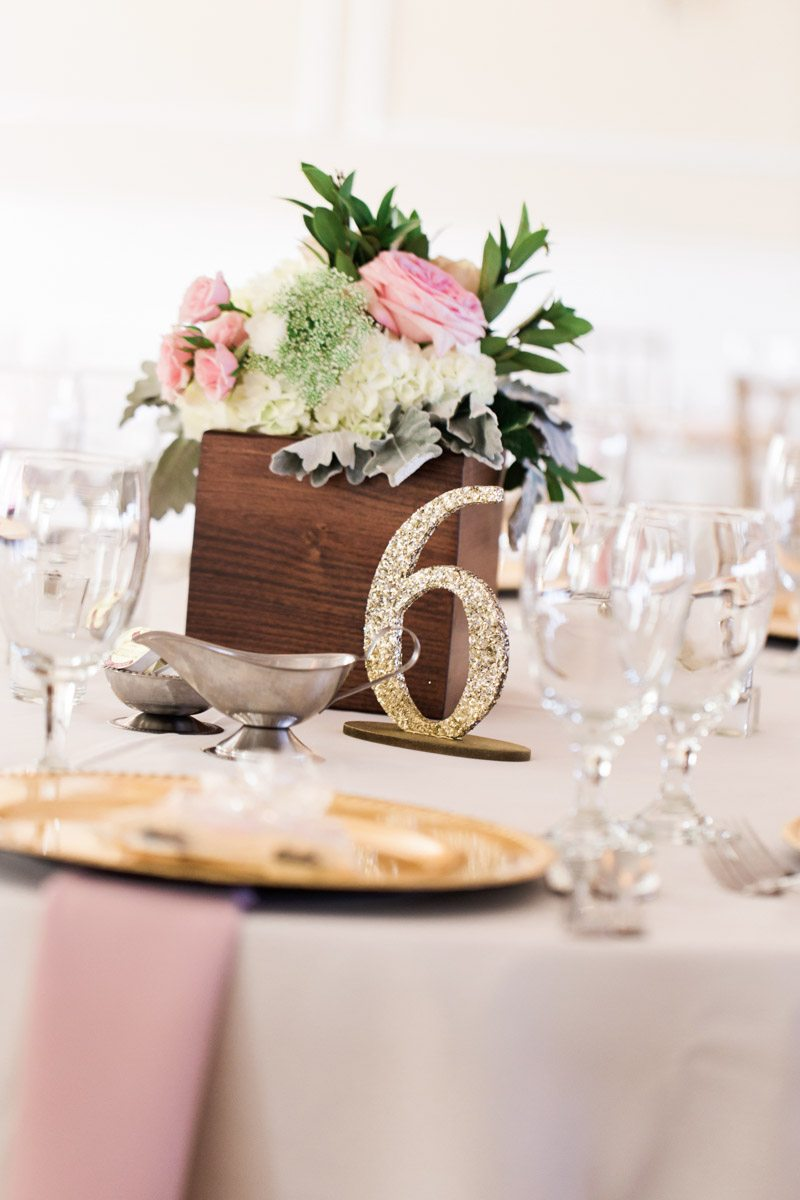 Close up of table number and wood floral centerpiece christyandtaylor-w-0494