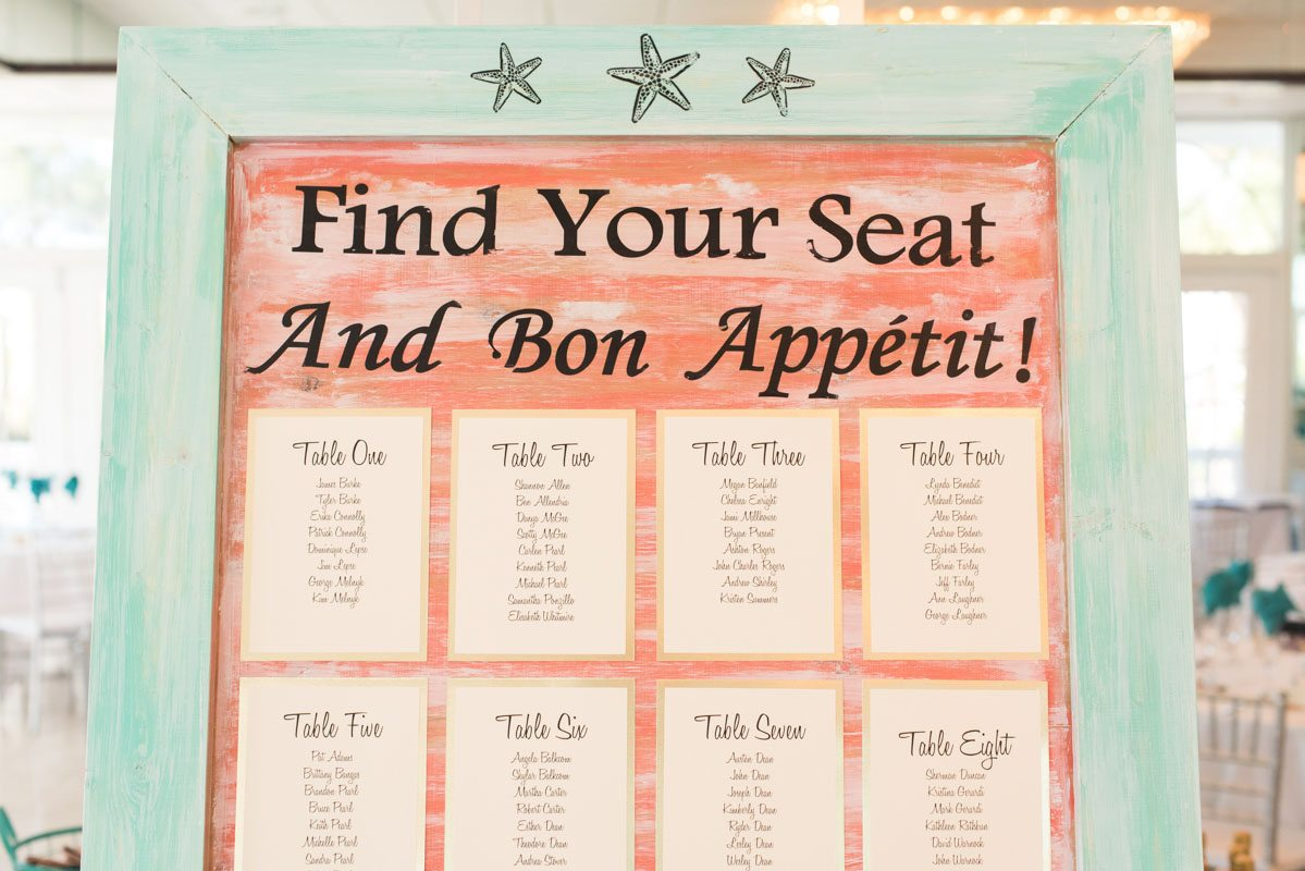 Coral and teal seating chart Pearl_Warnock_Caroline__Evan_Photography_MichaelaChrisWedding1757