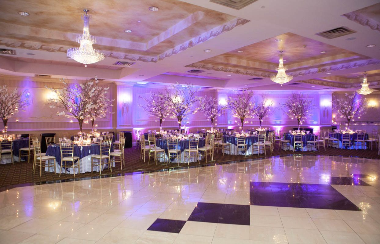 Dance floor and purple uplighting with tree centerpieces Lathrop__5th_avenue_digital_025220141213JDAARachelOshinBM