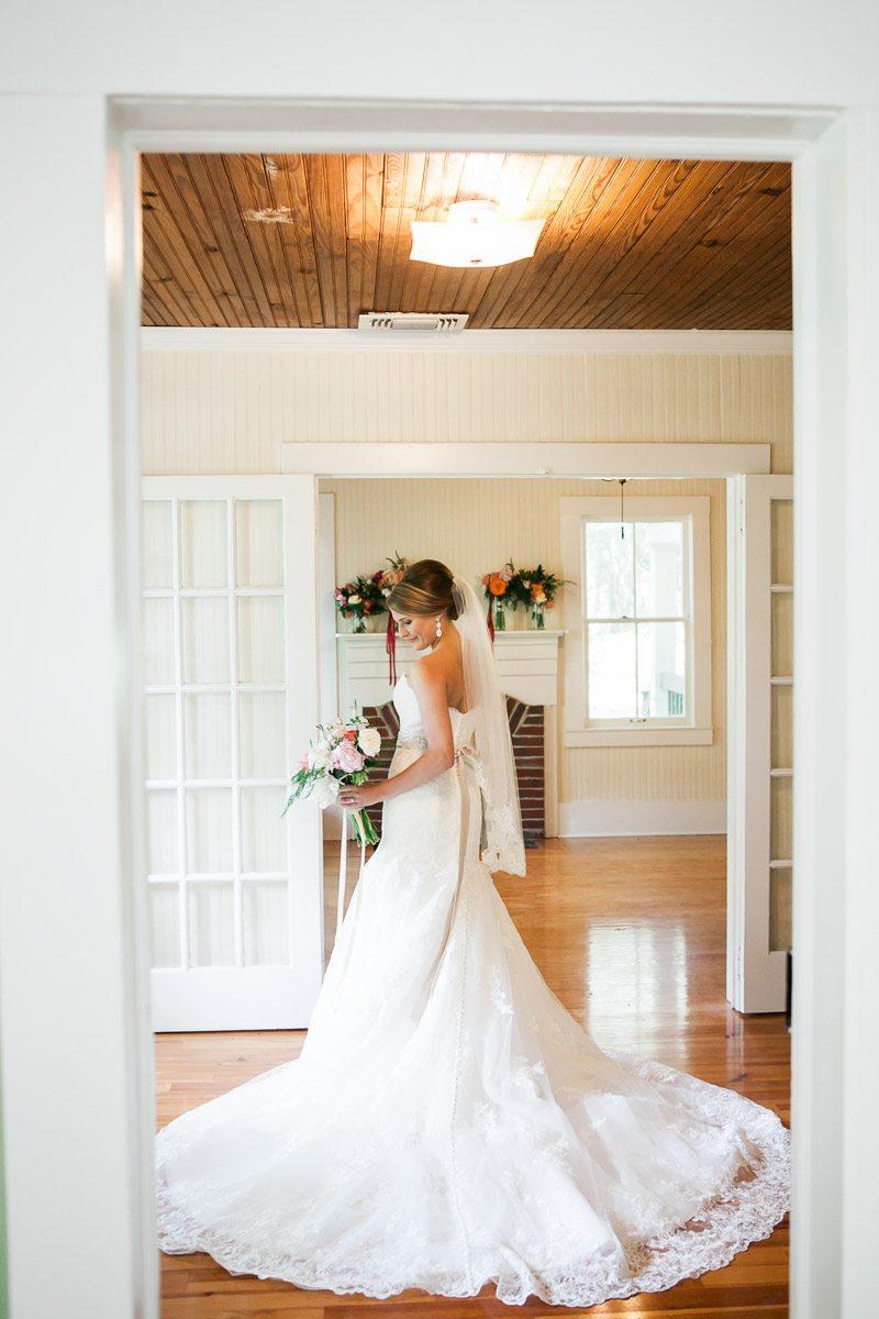 Elegant Pose Bride in Dress Holding Bouquet